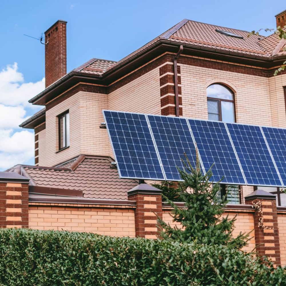Modern home with installed solar panels. Sun energy source to produce electricity for own needs