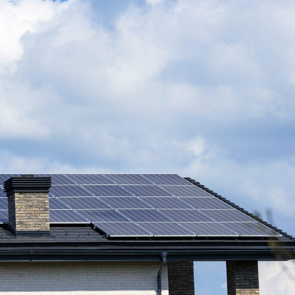 roof of a residential building with solar panels. Green energy and energy independence concept